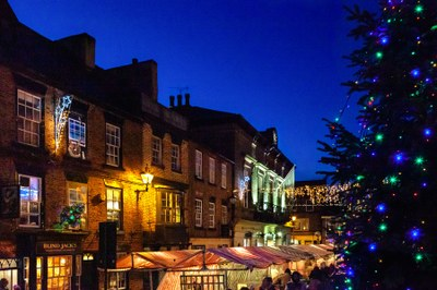 Market and Christmas Tree at Night